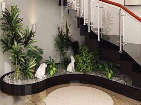 Sự đồng bộ giữa tiểu cảnh cầu thang và tường sẽ tạo nên một không gian hài hòa, nhã nhặn