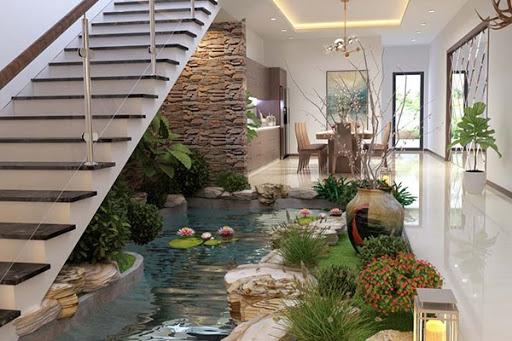 Nước, hòn non bộ, cây xanh, đèn trang trí....là những vật liệu chính khi thiết kế tiểu cảnh cầu thang nước
